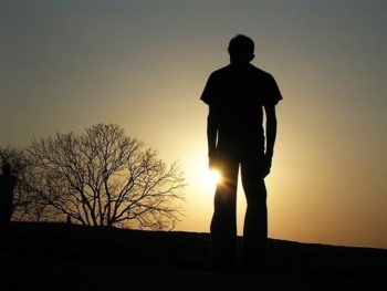 silhouette of man sunset stock